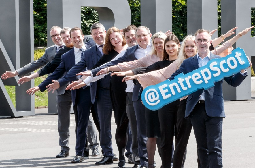 Edinburgh Airport staff and Entrepreneurial Scotland outside the airport
