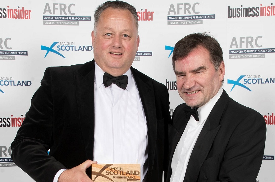 Two men with an award which reads Made in Scotland Business Insider