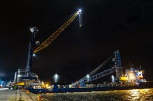 Crane at dockside at night